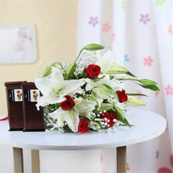 The gift contains a combination of 5 White Lilies With 5 Red Roses along with 2 bars of Temptation chocolate