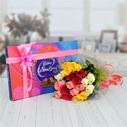 20 multicolor roses bunch (5 white, 5 red, 5 yellow and 5 pink roses), tasty cadbury celebrations (141.9g)