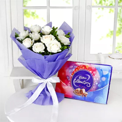 Everyone loves giving surprises, Bunch Of 10 White Roses  Cadbury Celebrations packet of 118 gms