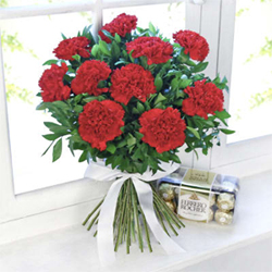 This exclusive bouquet of 10 red carnations, along with a pack of 16 Ferrero Rocher chocolates