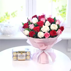 This gift hamper including a bunch of 25 assorted roses and a packet of tempting 16pcs Ferrero Rocher chocolates