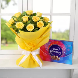 This gift hamper,comprising of a bunch of 12 yellow roses and a Cadbury Celebrations chocolate box