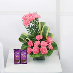 The bouquet includes 15 fresh pink carnations+ Cadbury Dairy Milk Silk 60gms (2 units)