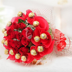 Rosy Rocher Bouquet - 16 yummy Ferrero Rocher chocolates on the periphery and 10 fresh Red Roses