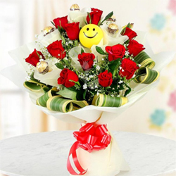 Smile All the Way. You cannot ask for anything better. 12 red roses with 5 Ferrero Rocher chocolates and a smiley ball packed in an attractive bunch