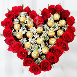 Heart shaped bouquet of 25 Red Roses  Arrangement of 16 Ferrero Rochers in Bouquet Centre