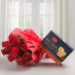 12 Red roses in addition to the box of soan  papdi 500 gms which promises a delightful hamper
