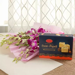 This combo with purple orchids with tempting Soan Papdi is definitely going to satiate the taste buds of the gift 6 Purple Orchids bunch-500 grams soanpapdi