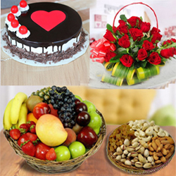 50 Red roses round basket 1kg Round black forest cake+ Seasonal Fruits contains Apples,Grapes Pomgranites,Kivi fruit + 400 Gms Dry Fruits decorated on a basket