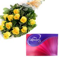 12 yellow roses bunch + small Cadbury Celebrations box