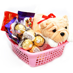 Basket of Imported Chocolates: Ferrero Rocher 16pc 1 Nos, Nutties Small Box, Cadbury Fruit Nut 2 Nos, Small Cara-milk toffees with a Soft toy.