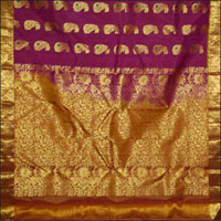 Gorgeous majenta color weaved with floral design spread smoothly over the pure Kanchipuram silk. An extraordinary golden leaves creeps its way through in the border and with glittering pallu to complete the beauty of beauty. 