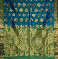 Luxgreen color kanjeevaram silk saree with mixed Green and mustard zaree Border, body arranged with 240 buttas and pallu compactly woven with Border. Blouse piece<br>NOTE: Same day Delivery for Guntur Vijayawada Hyderabad and Secunderabad. For other places requires minimum 2 to 3 WORKING DAYS.