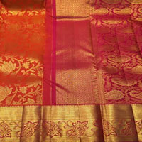 Kalaneta pattu Saree with contrast mustard and maroon tested Zaree Big Border, and dorilines Buta all over the Saree and Meena work on pallu. Blouse piece included. Suitable for all age groups.