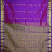 Contrast Rust N Magenta Colour fancy soft silk saree with violet fancy zaree Border, body arranged with buttas and pallu compactly woven with floral pattern Border. Blouse piece  <br>NOTE: Same day Delivery for Guntur Vijayawada Hyderabad and Secunderabad. For other places requires minimum 2 to 3 WORKING DAYS.