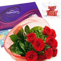 Bunch of 12 Red Roses with green leaves coupled with Cadbury's Celebrations Pack to express your heartfelt feelings