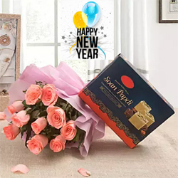 sweet gift hamper that includes bunch of 10 pink roses and a box of tasty 500 grams Soan Papdi