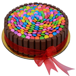 Buy this gorgeous cake for your special one which is aesthetically carved by traditional creamy chocolate in the perfect round shape and multicolor gems