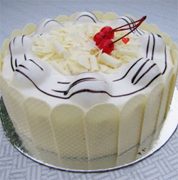 White Forest, White chocolate blended into layers of rich vanilla cake with rich whipped cream and delicious cherries.