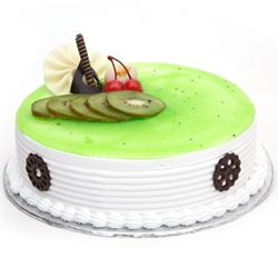 Nothing can be more delightful and healthy than this fruit cake flavored with Kiwis on the top, Cakes to Bangalore