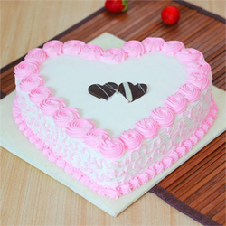 Charm your loved one with this specially curated heart-shaped strawberry cake, Cakes to Delhi