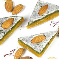 Barfi made of Dry Fruit Burfi  and decorated with silver foil. Barfis are an all-time favourite