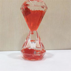 Paper weight with heart valentines day Show Pieces plastic/glass made. <br> 5 inch height. lead time 2 to 3 working days