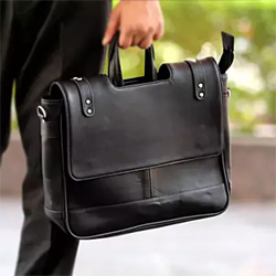 A black office bag is one of the must carry accessory that you need. This black bag with good space will suffice all your requirements. The most stylish way to carry your essentials to work is this black bag. 