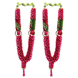 The beauty of thousands of rose petals folded comes in the shape of lovely garlands for special occasions like engagements, marriage receptions or any felicitations. Richness of these roses enhanced with the use of pearls.  Note: Flowers may vary slightly from the image depending upon the local availability
