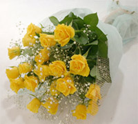 Bunch of 30 Yellow roses wrapped with net and a ribbon bow.