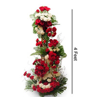 Make their every moment memorable with this life size arrangement of 50 red and 50 white roses  - 3 feet height