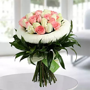 20 Luxurious arrangement of gorgeous pink and white roses will add style and class to your loved ones day  <br> design may vary as per local florist possibility.
