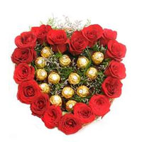 Here is a stunning arrangement of 20 red roses with 16 pcs Ferrero Rocher in heart shape to show your deep and divine love. , Flowers to Bangalore