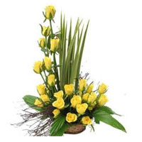 a perfect gift for cheering up a friend or loved one. Arrangement of 25 Yellow Roses in a Basket., Flowers to Bangalore