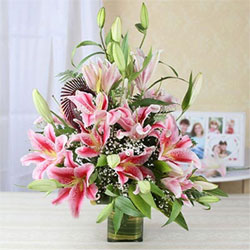 This pretty bunch of 15 pink lilies is extremely beautiful, and is an ideal gift that graces every occasion, Flowers to Bangalore