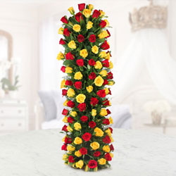 send this long arrangement of 100 Red and yellow roses