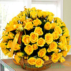 It is a heart-warming arrangement of 100 bright yellow roses surrounded by garden fresh greenery to complete the look. Skillfully placed in a round basket , Flowers to Bangalore