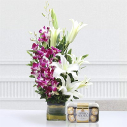 This unique hamper featuring a Vase of 5 Purple Orchids and 3 Lilies with 16 Pcs Ferrero Rocher Box is curated for special occasions by our experts.