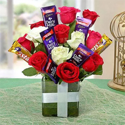 Buy this lovely glass vase arrangement of red and white roses 