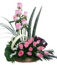 Basket of 24 Pink Roses surrounded by Gypsophila in a Basket. Send this enchanting flower basket to India, Flowers to Bangalore