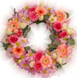 A floral tribute to the departed soul with this wreath of pastel shades gerberas and roses.