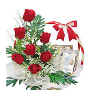 Ferrero rocher 16 piece box with 10 red roses in a basket