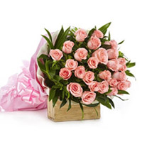 A delicately wrapped, hand-bunch of 36 gorgeous pink Roses with green leaf and knot it with pink lace make it perfect.
