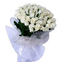 Bouquet of 24 white flower wrapped in a cellophane