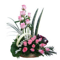 Basket of 24 Pink Roses surrounded by Gypsophila in a Basket. Send this enchanting flower basket to India