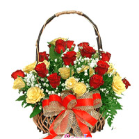 Round basket of 30 red and yellow roses to celebrate those joyful