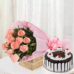 This is called the hamper of pure love and only the sweetest person in your life deserves this. 12 pink roses bunch 500 gms black forest cake