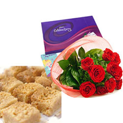 1/2kg Ajmeri Kalakan + Bunch of 12 Red Roses with green leaves coupled with Cadbury's Celebrations Pack.