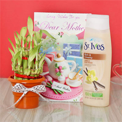 Bring a smile on your mom's face with a hamper of a St. Ives rich and creamy vanilla body wash, a 2 layered good luck bamboo plant in a plastic pot and a greeting card