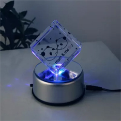 The crystal cube has picture of mom panda with kid panda and a personalized picture of you and your mom which rotates and lights up with the LED.